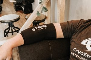 customer wearing a normatec freeze sleeve