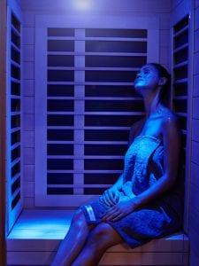 woman using infrared sauna