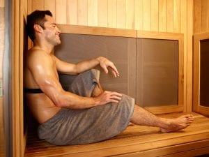 Man using infrared sauna